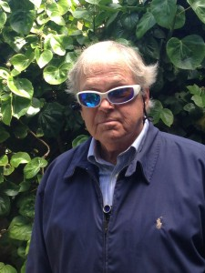 Blind man Ed Gallagher, using Genoa Services. Only the wide-angle lens of the genoa system sticking out of the front of his zipped up jacket.